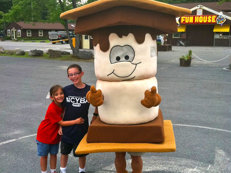Kids posing with Toasty, our S'mores mascot