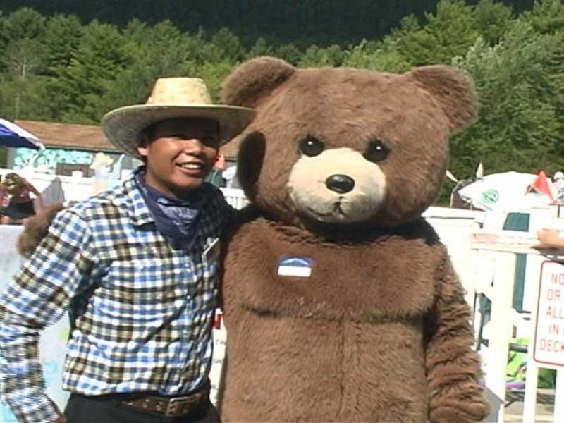 Bear mascot posing with cowboy