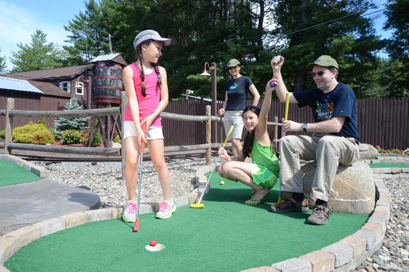 Celebrating a putt on our mini-golf course