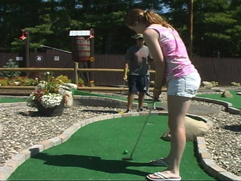 Sinking a putt on our mini-golf course