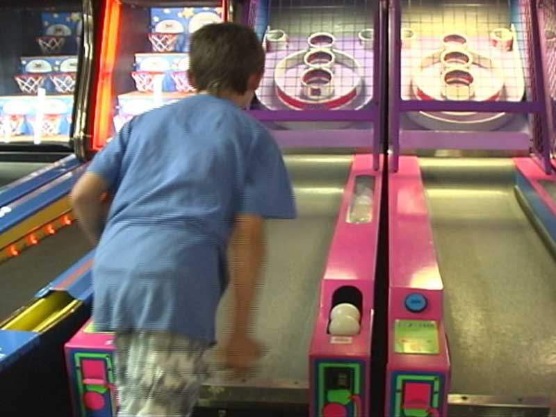 Kid enjoying a game of Skee-ball