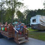Families enjoying a wagon ride