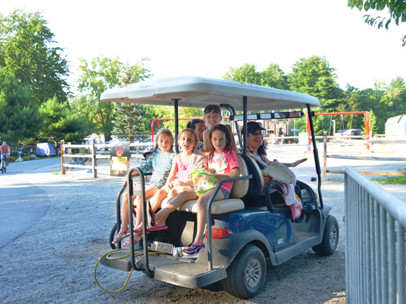 Kids riding on a golf cart
